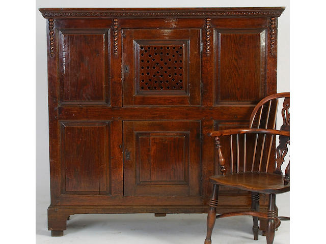 An early 18th Century oak food cupboard,</r> 141 x 146 x 49cm