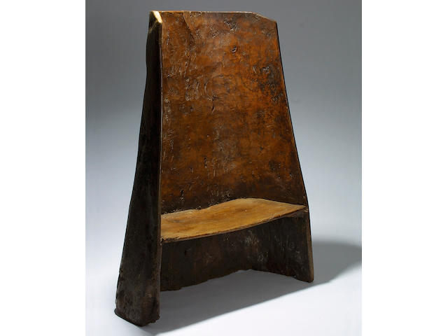 A rare 18th Century elm 'dug-out' chair or small settle, South West England,</r> 141 x 103cm.
