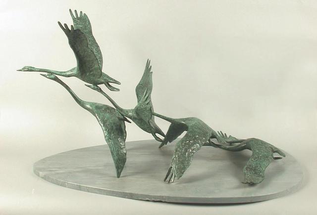 David Wynne (British, b.1926) Swans in Flight 54 x 90 x 66 cm.