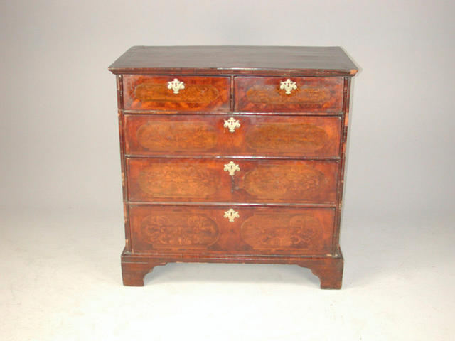 A William and Mary walnut and marquetry chest of drawers handles missing, replaced bracket feet and escutcheons, damage to veneer