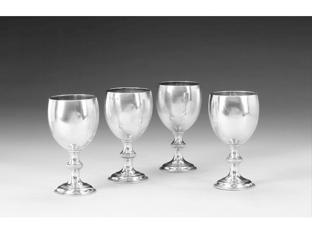 A matched set of four silver goblets, George III/Victorian, comprising a pair by Aldridge & Green,