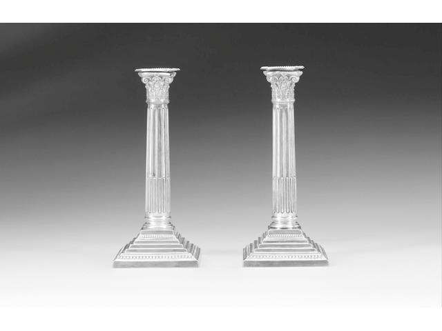 A pair of late Victorian silver Corinthian column candlesticks, by Ball Bros., Birmingham 1897,