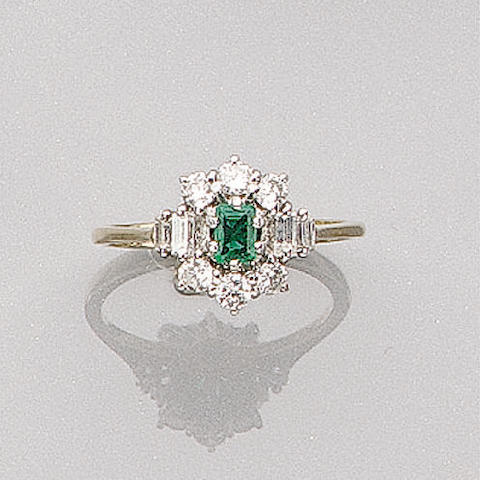 A Diamond and Emerald Ring,