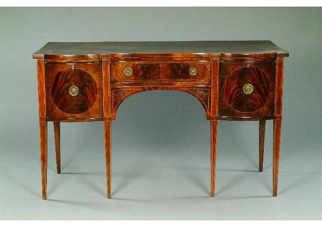 A George III style crossbanded mahogany sideboard,