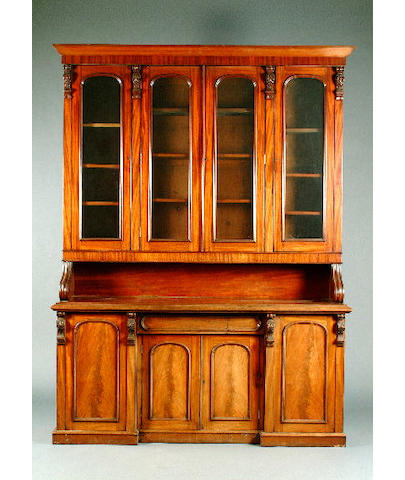 A mid Victorian mahogany bookcase cabinet, 190cm wide, 60cm deep, 258cm high.