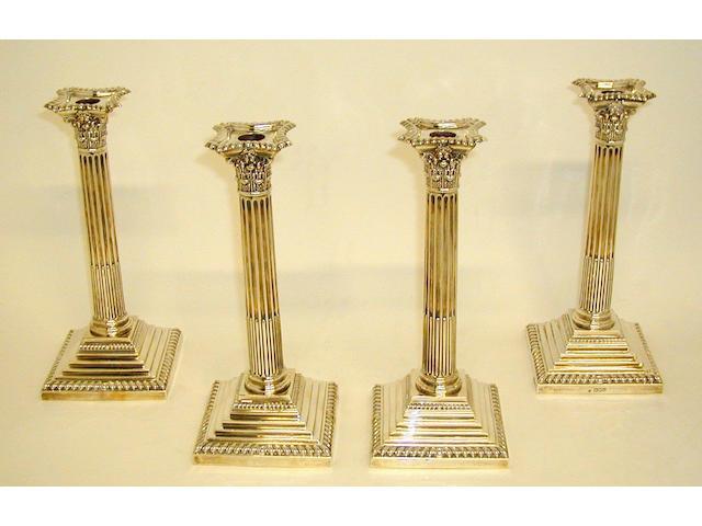 A set of four late Victorian Corinthian column candlesticks,