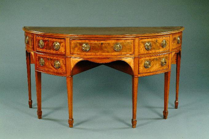 A George III mahogany and crossbanded semi-circular sideboard,