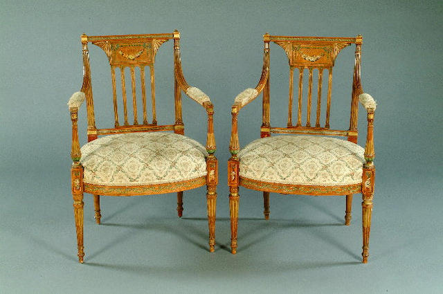A pair of Edwardian painted satinwood open arm elbow chairs,