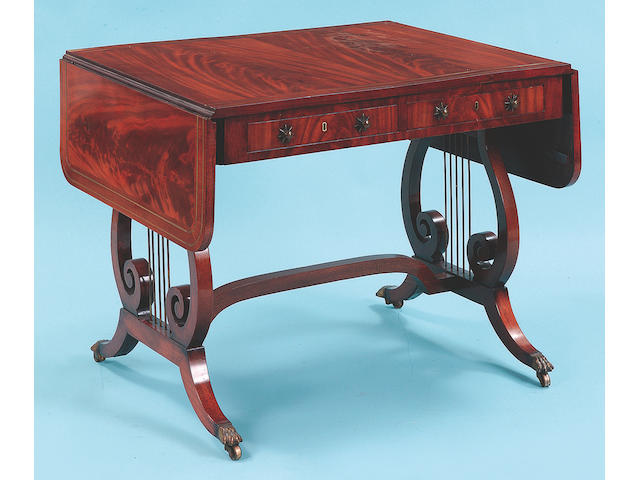 A Regency mahogany sofa table, <I>93cm wide</I>.