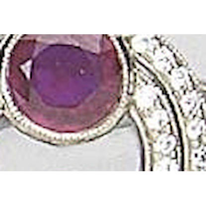 A ruby and diamond oval panel ring