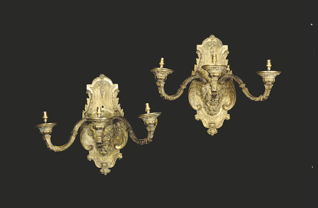 A pair of Regence style gilt metal two branch appliques,