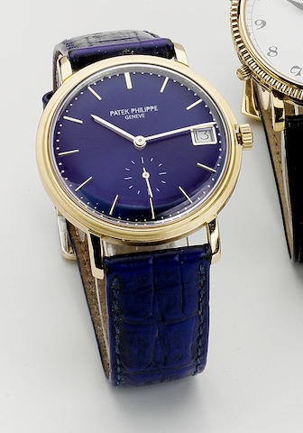 Patek Philippe.  An 18ct gold automatic centre seconds calendar wristwatch Ref: 3445, case number 328635, movement number 1118469, circa late 1960s 35mm