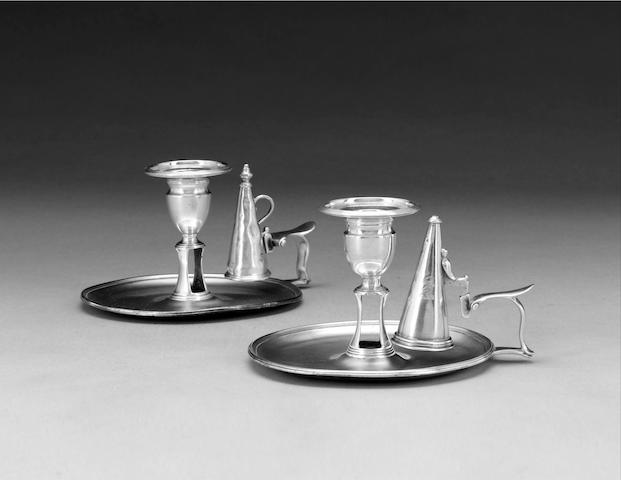 A Geogre III silver chamberstick, by John Scofield, London 1787, and a further George III silver chamberstick, by the same maker (2)