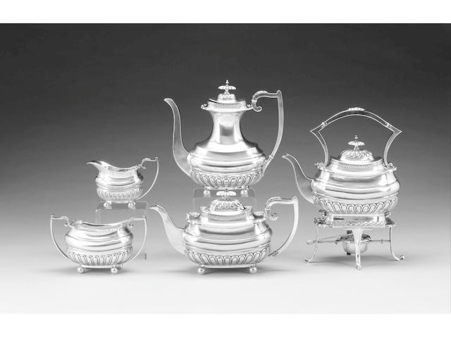 A four piece silver tea and coffee set and a kettle on stand, by Walker & Hall, Sheffield 1914,