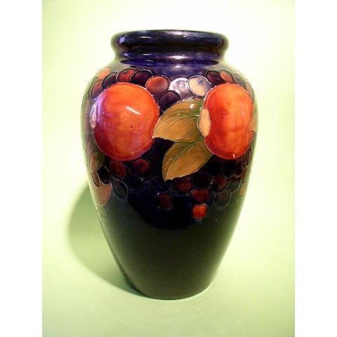 A large Moorcroft 'Pomegranate' vase, 33cm, impressed facsimile signature, painted signature in blue.