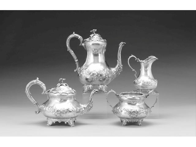 A Victorian Irish silver four piece tea and coffee set, by Samuel Le Bas, Dublin 1862/3, (all 1862 except cream jug 1863) and retailed by DONEGAN,