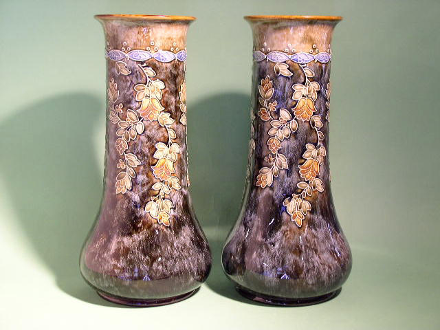 A pair of Doulton Lambeth vases by Bessie Newberry,
