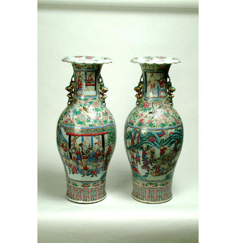 A pair of Canton Famille Rose floor vases 62 cm high. (2)