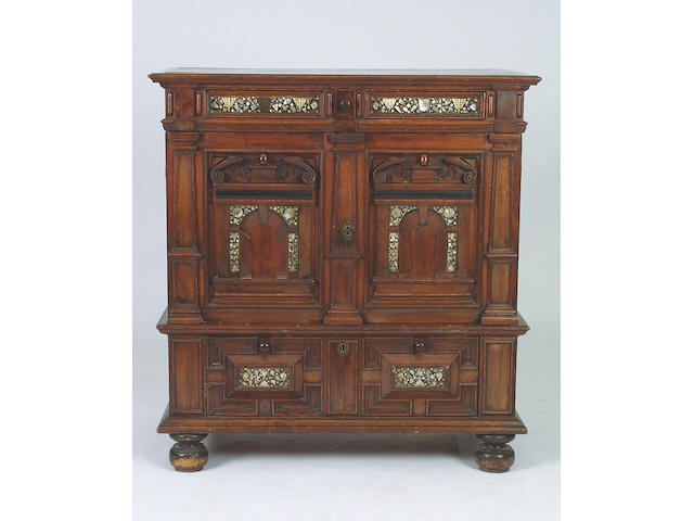 A mid 17th Century oak, walnut and mother of pearl inlaid chest, 133 x 126 x 66cm