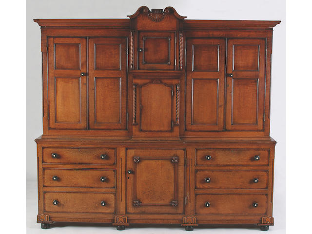 An early 19th Century light oak and mahogany crossbanded kitchen cupboard, 222 x 240 x 42cm.