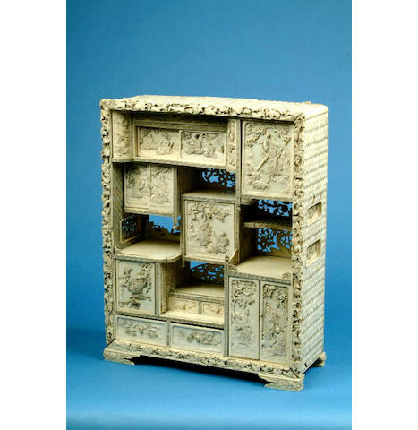 A Japanese ivory and lacquer table cabinet 43.5 cm high.