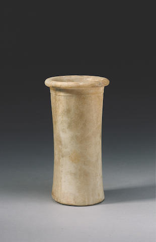 A sizeable Egyptian alabaster cylindrical jar Old Kingdom, circa 3rd Millennium B.C.