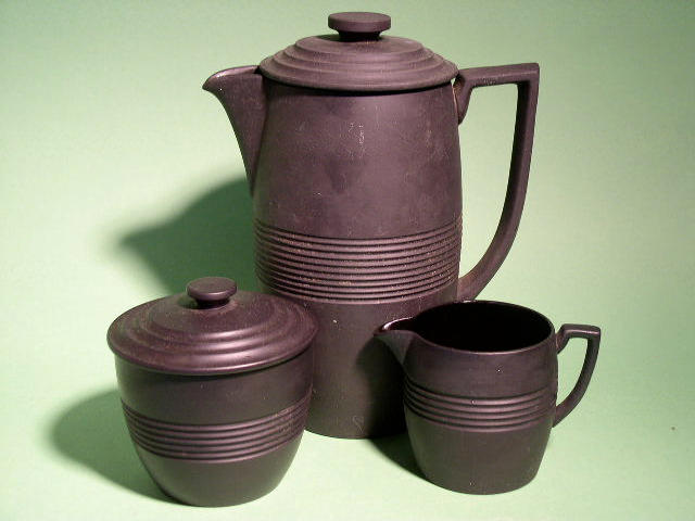 A Wedgwood basalt coffee set by Keith Murray,