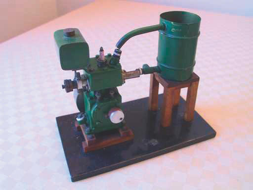 """A small model of a vertical single-cylinder, four-stroke petrol engine, 5 1/4"""" x 6 5/8"""" (133mm x 175mm)"""