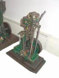 "A small full-size vertical reversing single-cylinder marine steam canoe engine, circa 1925, 21"" x 13 1/4"" (534mm x 336mm)"