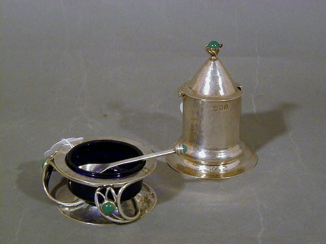Charles Robert Ashbee, attributed, for Guild of Handicraft, 1900-1904 A Silver Mustard Pot with Spoon 7.5cm diam and 9cm high, both pots with 'GoH Ltd', with London hallmarks for 1900, 1901 and 1904 respectively  (3)
