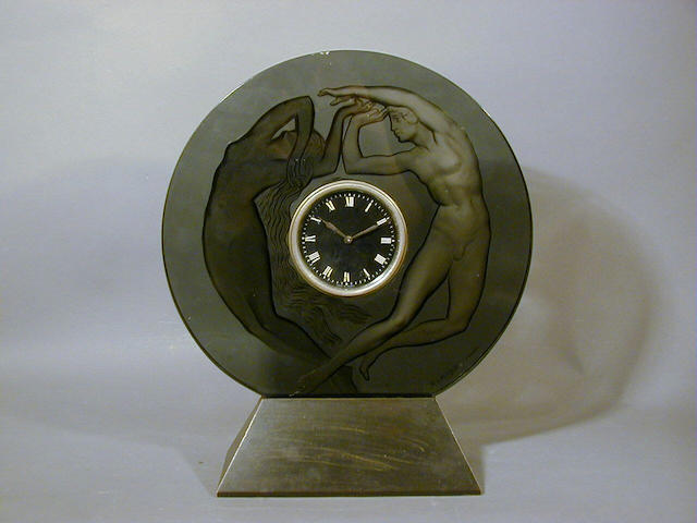 René Lalique, design 1926 'Le Jour et La Nuit', A Smokey Grey Clock 37.5cm high, etched 'R.Lalique France'