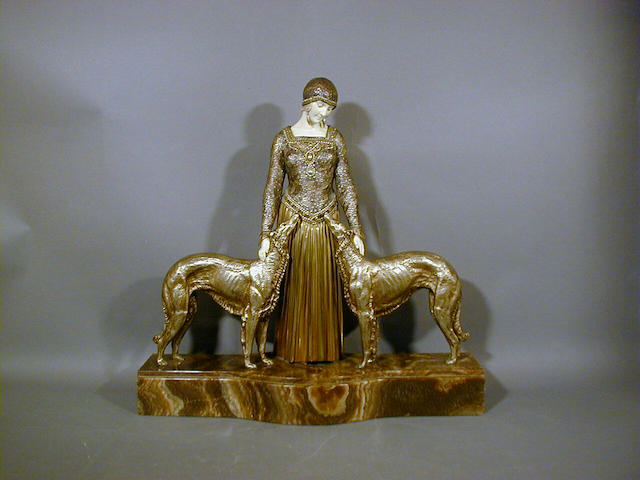 Dimitri Chiparus, circa 1920 'Les Toujours des Amis', A Gilt Bronze and Carved Ivory Group 41cm high, 43cm long, signed on base