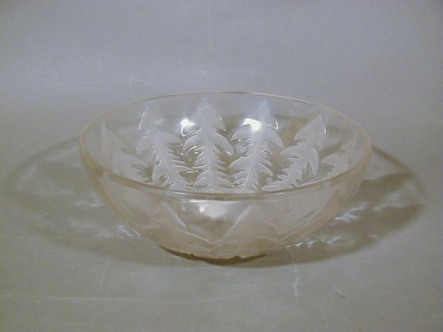 René Lalique, design 1921 'Pissenlit', A Clear and Frosted Bowl the bowl 24cm diam, moulded 'R Lalique France', the dish 16cm diam, engraved 'R Lalique France' (2)