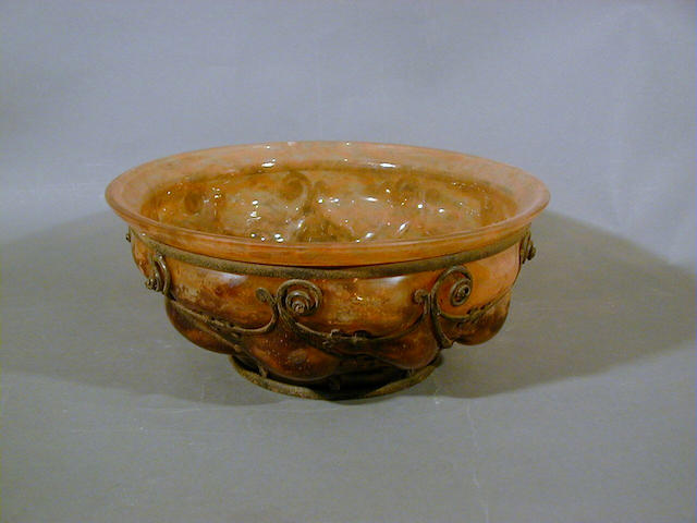 Daum and Majorelle, circa 1920 A Wrought-Iron Mount and Glass Bowl 28.5cm diam, etched 'Daum Nancy' and 'L.Majorelle'