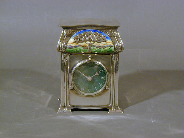 Liberty & Co, 1903 A 'Cymric' Silver and Enamel Timepiece 11.5cm high, stamped 'L&Co' and 'Cymric' and with Birmingham hallmarks for 1903