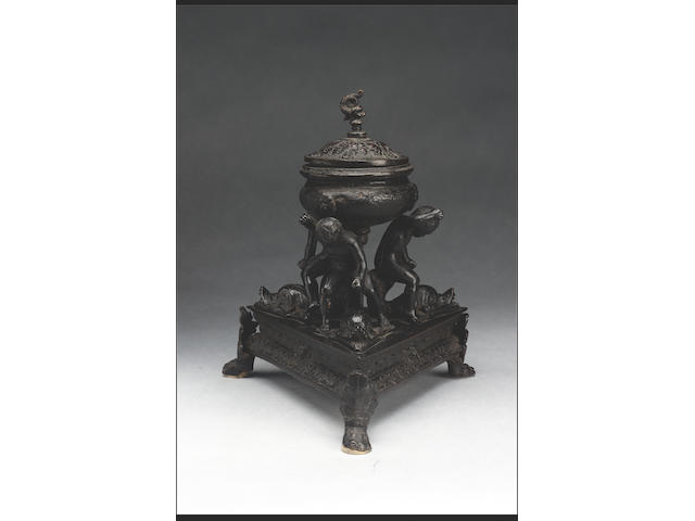 An Italian dark brown patinated bronze inkwell, 19th century, 28cm high