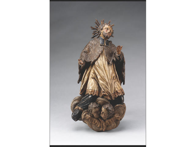 A German polychrome carved wood Figure of St. John Nepamuk, 17th century, 52cms high
