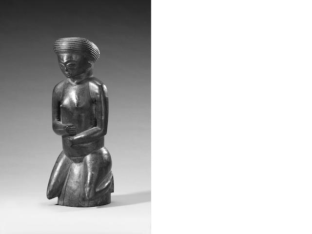 Chokwe wood figure of a kneeling woman Angola 28cm.