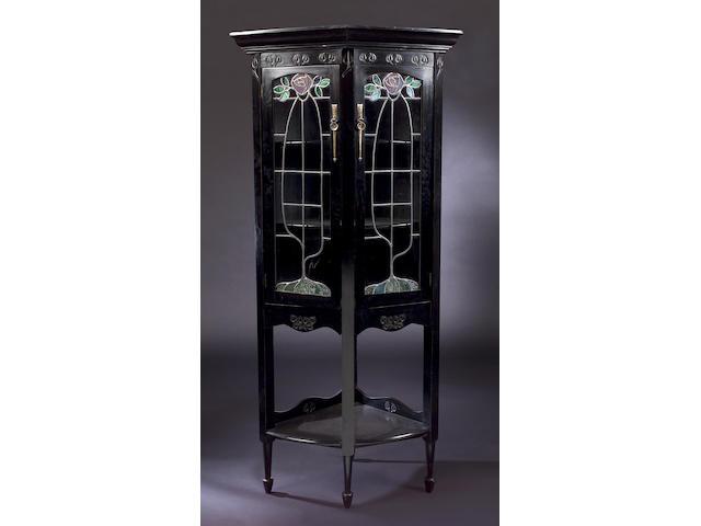 A Scottish ebonized corner cabinet, In the Glasgow Style, 88cm x 187.5cm x 62