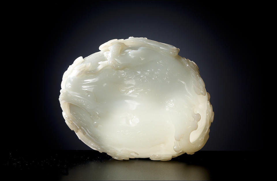 An Imperial large white jade 'pine trunk' oval bowl (no129 p73)