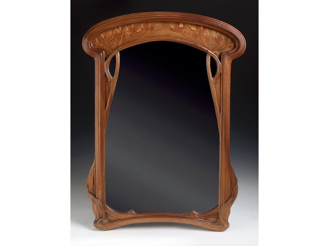 Emille Galle, A marquetry wall mnirror, 74cms high, carved signature 'Galle'