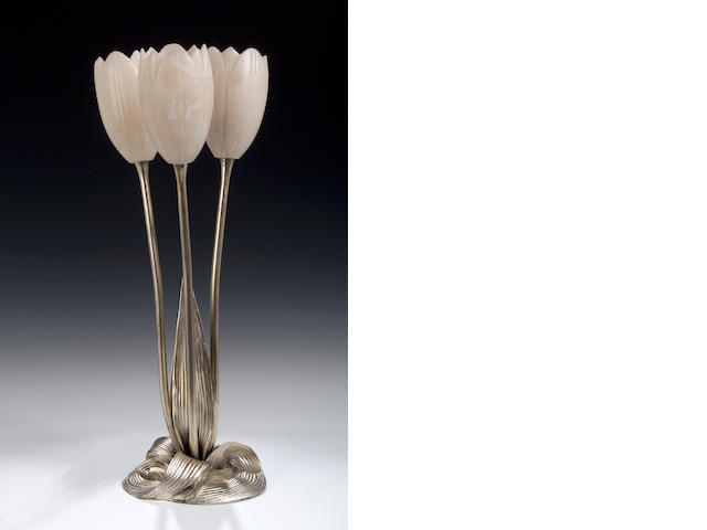 Albert Cheuret, A silvered bronze and alabaster lamp, 40cms high, inscribed 'Albert Cheuret'