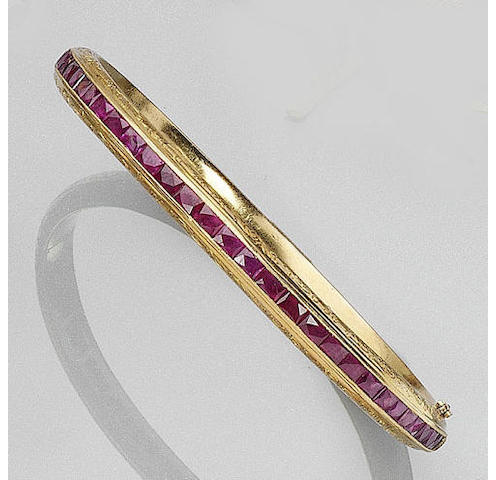 A ruby hinged bangle,