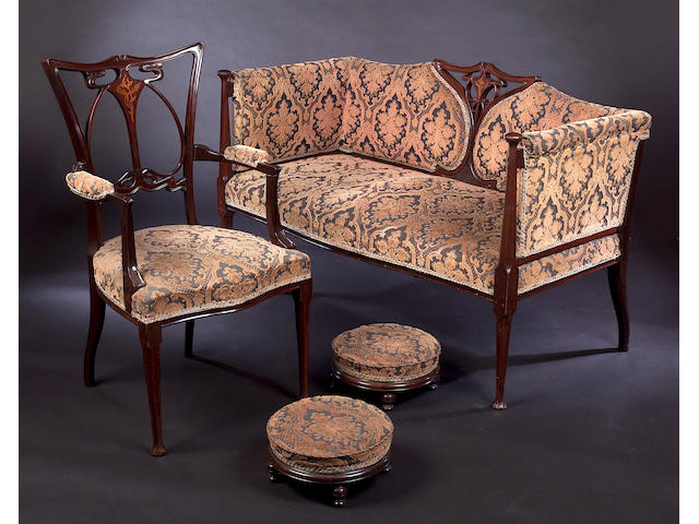 An Art Nouveau mahogany and inlaid parlour suite, (9)