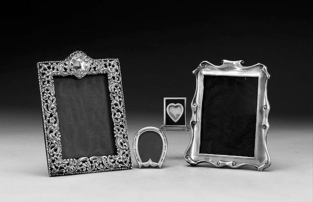 "An Edwardian silver photograph frame, maker's mark ""M & Co. Ltd."", Birmingham 1903, three other photograph frames (4)"