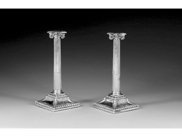 "A pair of George III silver candlesticks, maker's mark ""F.K"" or ""W F"" in Gothic letters (Grimwade 3572), unidentified, London 1766,"