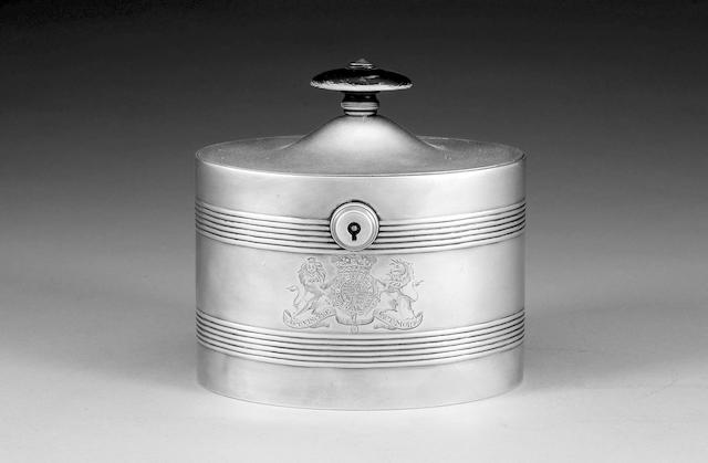 A George III oval silver tea caddy by Henry Chawner, London 1789,
