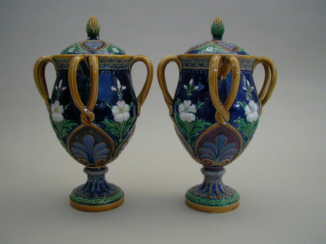 A pair of Minton Majolica vases and covers,  29cm high.(4)