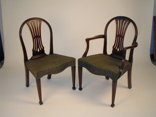 A set of twelve George III style mahogany dining chairs,
