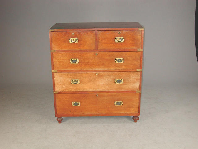 A 19th century mahogany campaign chest, with two short and three long graduated drawers with camphor wood linings, on knopped feet 9...